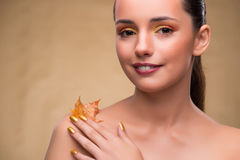 The beautiful woman in with autumn dry leaves. Beautiful woman in with autumn dry leaves stock image