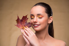 The beautiful woman in with autumn dry leaves. Beautiful woman in with autumn dry leaves stock images