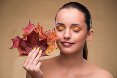 The beautiful woman in with autumn dry leaves. Beautiful woman in with autumn dry leaves stock photo