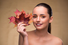 The beautiful woman in with autumn dry leaves. Beautiful woman in with autumn dry leaves stock photography