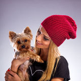 Beautiful woman with autumn fashion - Embracing yorkshire terrier dog Stock Photos