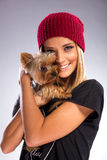 Beautiful woman with autumn fashion, holding yorkshire terrier dog Stock Photo