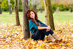 Beautiful woman in autumn forest Stock Images