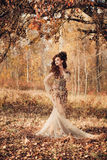 Beautiful woman in autumn forest Royalty Free Stock Photo