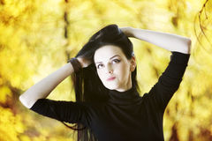 Beautiful woman in autumn forest Royalty Free Stock Image