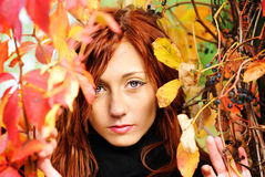 Beautiful woman and autumn leaf Stock Photo