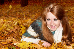 Beautiful woman on autumn leaves Royalty Free Stock Image