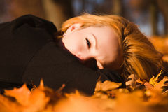 Beautiful woman on autumn leaves,close-up. Photo of beautiful woman on autumn leaves,close-up Stock Photography