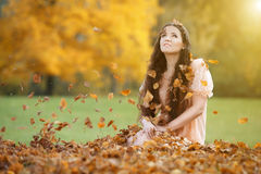 Beautiful woman among autumn leaves Stock Images
