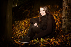 Beautiful woman in autumn leaves Royalty Free Stock Photography