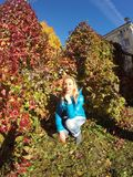 The beautiful woman in autumn park Stock Images
