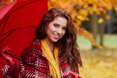Beautiful woman in autumn park Stock Images