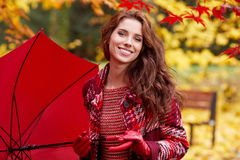 Beautiful woman in autumn park Stock Photography