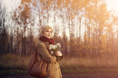 Beautiful woman in autumn park Royalty Free Stock Images