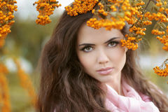 Beautiful woman autumn portrait, colorful park. Outdoor. Stock Photos