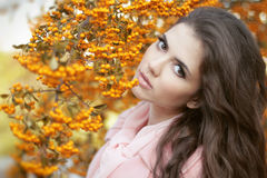 Beautiful woman autumn portrait, colorful park. Outdoor. Royalty Free Stock Photos
