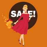 Beautiful woman at the autumn sales. Woman in red dress goes shopping. stock photos