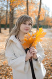 Beautiful woman in Autumn scenery. Relaxing outdoors Royalty Free Stock Image