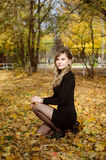 Beautiful woman in Autumn scenery. Relaxing outdoors Stock Image