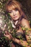 Beautiful woman in autumn scenery Stock Photo