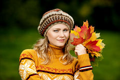 Beautiful woman in autumn wood Royalty Free Stock Photography