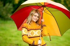 Beautiful woman in autumn wood Stock Photography