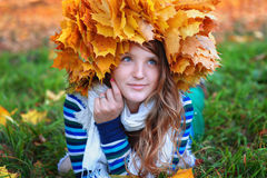 Beautiful woman in the autumn wreath of maple yellow leaves.  royalty free stock photography