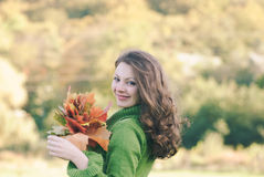 Beautiful woman with  autumnal maple leaves Royalty Free Stock Photos