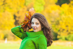 Beautiful woman with  autumnal maple leaves Stock Images