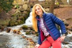 Beautiful woman at the autumnal park Stock Photo