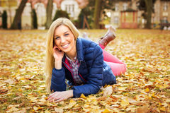 Beautiful woman at the autumnal park Stock Photography