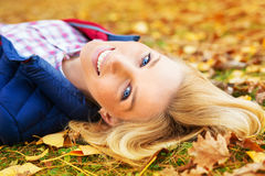 Beautiful woman at the autumnal park. Young beautiful woman at the autumnal park stock photography