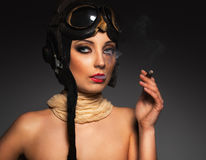 Beautiful woman aviator with a glamorous retro mak Stock Photos