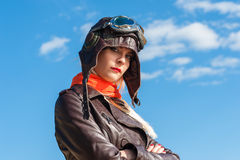 Beautiful woman in aviator helmet on the sky background Stock Images