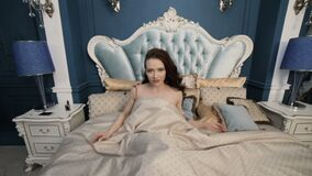 Beautiful woman is awake. Beautiful woman is awake, she is in the bedroom stock footage