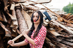 Beautiful woman with an ax in hands Stock Photography