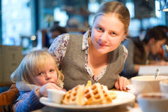 Beautiful woman with baby sit in cafe Royalty Free Stock Photos