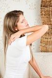 Beautiful woman with backache. Young, beautiful woman with backache stock images