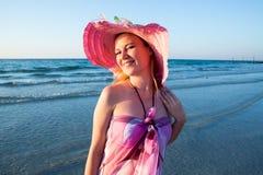 Beautiful woman on background of beach. Persian Gulf ,Dubai.Tanning girl near ocean, tropical resort Royalty Free Stock Images