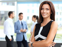 Beautiful woman on the background of business people Stock Images