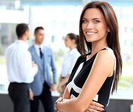 Beautiful woman on the background of business people Stock Photography