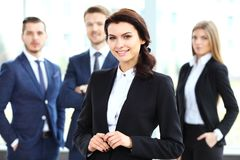 Beautiful woman on the background of business people Royalty Free Stock Photography