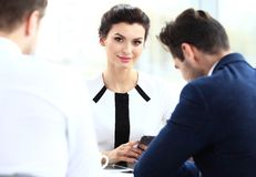 Beautiful woman on the background of business people Royalty Free Stock Images