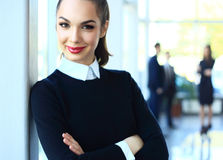 Beautiful woman on the background of business people Stock Photos