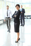 Beautiful woman on the background of business people Stock Image