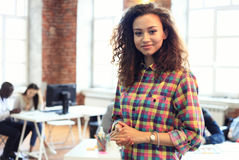 Beautiful woman on the background of business people Royalty Free Stock Image