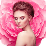 Beautiful woman on the background of a large flower Stock Images