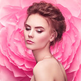 Beautiful woman on the background of a large flower Stock Photos