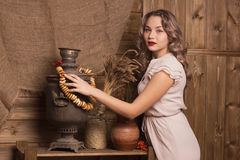 Beautiful woman on the background of the rural interior. Beautiful woman on the background on rustic kitchen Royalty Free Stock Photo