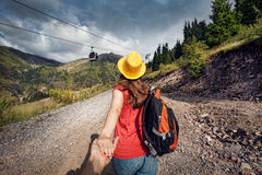 Beautiful woman with backpack in the mountains Royalty Free Stock Image